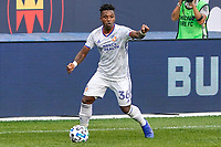 CHICAGO, UNITED STATES - AUGUST 25: Joseph-Claude Gyau #36 of FC Cincinnati #33 of FC Cincinnati dribbles the ball during a game between FC Cincinnati and Chicago Fire at Soldier Field on August 25, 2020 in Chicago, Illinois.