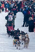 Jake Berkowitz team leaves the start line during the restart day of Iditarod 2009 in Willow, Alaska