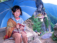 Young girl in front of the Tiger's Nest monastery in western Bhutan