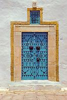 Tunisia, Sidi Bou Said.  Blue Door in Stone Frame.