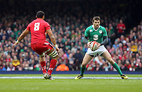 Pictured: Jared Payne of Ireland (R) marked by Taulupe Faletau of Wales (L) Saturday 14 March 2015<br />