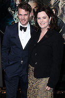 """HOLLYWOOD, CA - DECEMBER 02: Calum Gittins, Philippa Boyens arriving at the Los Angeles Premiere Of Warner Bros' """"The Hobbit: The Desolation Of Smaug"""" held at Dolby Theatre on December 2, 2013 in Hollywood, California. (Photo by Xavier Collin/Celebrity Monitor)"""