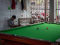 A recreational area with a pool table at the Jade Market in Mandalay, Myanmar, Burma