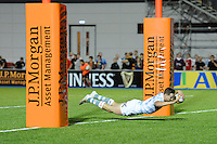 20130803 Copyright onEdition 2013 ©<br /> Free for editorial use image, please credit: onEdition.<br /> <br /> Will Smith of London Irish 7s dives over to score a try during the J.P. Morgan Asset Management Premiership Rugby 7s Series.<br /> <br /> The J.P. Morgan Asset Management Premiership Rugby 7s Series kicks off for the fourth season on Thursday 1st August with Pool A at Kingsholm, Gloucester with Pool B being played at Franklin's Gardens, Northampton on Friday 2nd August, Pool C at Allianz Park, Saracens home ground, on Saturday 3rd August and the Final being played at The Recreation Ground, Bath on Friday 9th August. The innovative tournament, which involves all 12 Premiership Rugby clubs, offers a fantastic platform for some of the country's finest young athletes to be exposed to the excitement, pressures and skills required to compete at an elite level.<br /> <br /> The 12 Premiership Rugby clubs are divided into three groups for the tournament, with the winner and runner up of each regional event going through to the Final. There are six games each evening, with each match consisting of two 7 minute halves with a 2 minute break at half time.<br /> <br /> For additional images please go to: http://www.w-w-i.com/jp_morgan_premiership_sevens/<br /> <br /> For press contacts contact: Beth Begg at brandRapport on D: +44 (0)20 7932 5813 M: +44 (0)7900 88231 E: BBegg@brand-rapport.com<br /> <br /> If you require a higher resolution image or you have any other onEdition photographic enquiries, please contact onEdition on 0845 900 2 900 or email info@onEdition.com<br /> This image is copyright the onEdition 2013©.<br /> <br /> This image has been supplied by onEdition and must be credited onEdition. The author is asserting his full Moral rights in relation to the publication of this image. Rights for onward transmission of any image or file is not granted or implied. Changing or deleting Copyright information is illegal as specified in the Copyright, Design and Pa