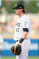 Charlotte Knights first baseman Andy Wilkins (17) on defense against the Gwinnett Braves at BB&T Ballpark on August 19, 2014 in Charlotte, North Carolina.  The Braves defeated the Knights 10-5.   (Brian Westerholt/Four Seam Images)