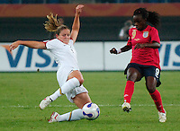 U.S. defender Cat Whitehill (4) goes in for a slide tackle. The United States (USA) defeated England (ENG) 3-0 during a quarter-final match of the FIFA Women's World Cup China 2007 at Tianjin Olympics Center Stadium in Tianjin, China, on September 22, 2007.