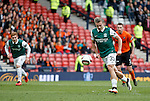 Jason Cummings dinks his penalty kick high over the bar during the first half of the match