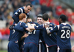 Yoann Arquin mobbed by tea mates after getting the second goal for Ross County