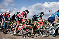 peloton over the Plugstreet gravel section.  <br /> <br /> <br /> 9th Gent-Wevelgem in Flanders Fields 2020<br /> Elite Womens Race (1.WWT)<br /> <br /> One Day Race from Ypres (Ieper) to Wevelgem 141km<br /> <br /> ©kramon