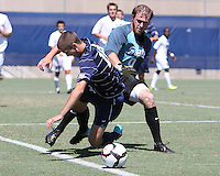 Steve Neumann #18 of Georgetown University battles with Avery Steinlage #0 of Michigan State during an NCAA match at North Kehoe Field, Georgetown University on September 5 2010 in Washington D.C. Georgetown won 4-0.