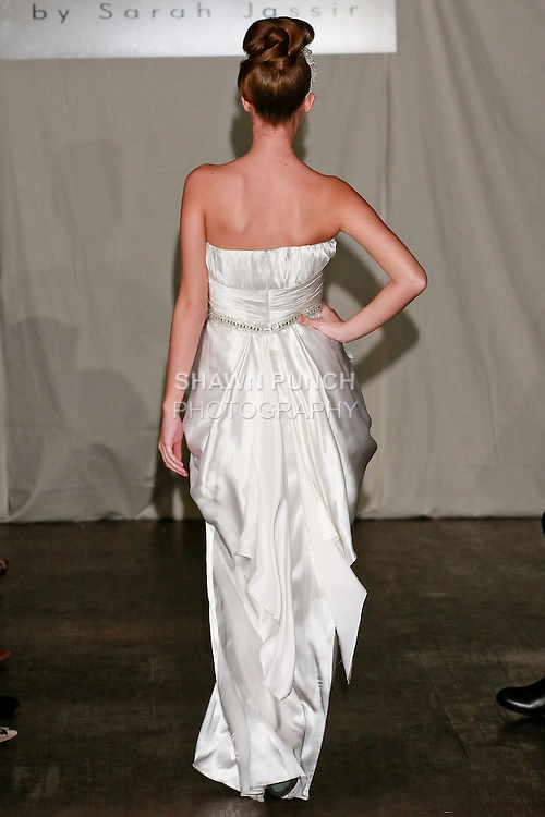 Model walks the runway in a Vivien wedding dress - silk charmeuse with Swarovski Crystals belt, by Sarah Jassir for the SARANTINA by Sarah Jassir Spring 2011 runway show, during New York Bridal Week Spring 2011.