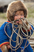 Bovanenkovo ,Yamal Peninsula, Russia, 09/07/2010..A Nenets boy holds a lasso for catching the tribe's reindeer at an overnight camp as the indigenous nomadic herders head north on sledges to the Russian Arctic coast.