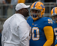 Pitt defensive line coach Tom Sims motivates defensive lineman Rashad Wheeler. The Pitt Panthers defeated the Georgia Tech Yellow Jackets 37-34 at Heinz Field in Pittsburgh, Pennsylvania on October 08, 2016.