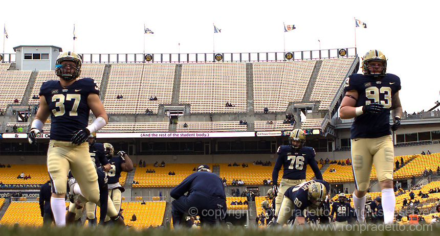 Pitt defensive linemen David Durham (37) and Bryan Murphy (93) warm up before the game. The Miami Hurricanes defeated the Pitt Panthers 41-31 at Heinz Field, Pittsburgh, Pennsylvania on November 29, 2013.