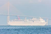 Cruise Ship Carnival Inspiration leaving Tampa Bay under the Sunshine Skyway Bridge.