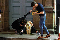 Pictured: A young woman sits on the pavement in Swansea. Tuesday 31 December 2019 to Wednesday 01 January 2020<br /> Re: Revellers on a night out for New Year's Eve in Wind Street, Swansea, Wales, UK.