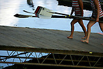 Rowers from Florida Tech carry their oars back to land following a third place finish in the Women's Varsity Heavyweight Eight Division II &III Final during the 68th Dad Vail Regatta on the Schuylkill River in Philadelphia, Pennsylvania on May 13, 2006.........