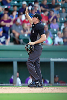 Umpire Tyler Witte works a game between the Greenville Drive and the Winston-Salem Dash on Tuesday, June 29, 2021, at Fluor Field at the West End in Greenville, South Carolina. (Tom Priddy/Four Seam Images)