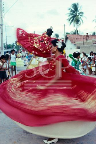 Recife, Pernambuco State, Brazil; Maracatu carnival dancer in red dress.