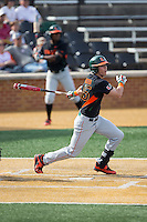 Carl Chester (45) of the Miami Hurricanes follows through on his swing against the Wake Forest Demon Deacons at Wake Forest Baseball Park on March 21, 2015 in Winston-Salem, North Carolina.  The Hurricanes defeated the Demon Deacons 12-7.  (Brian Westerholt/Four Seam Images)