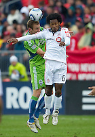 25 April 2010: Seattle Sounders defender Tyson Wahl #5 and Toronto FC midfielder Julian de Guzman #6 in action during a game between the Seattle Sounders and Toronto FC at BMO Field in Toronto..Toronto FC won 2-0....