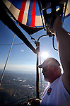Pilot Bob Raper flies over North Reno on media day of the 32nd annual Great Reno Balloon Race in Reno, Nev., on Thursday, Sept. 5, 2013.  <br /> Photo by Cathleen Allison