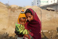 Shabhan Sheikh Siddique (1) is held by his mother outside the family home in a poor community of Kanpur. He suffers from cataracts and is one of a growing number of children in the community suffering from developmental issues believed to have been caused by increased exposure to water pollution whilst in the womb