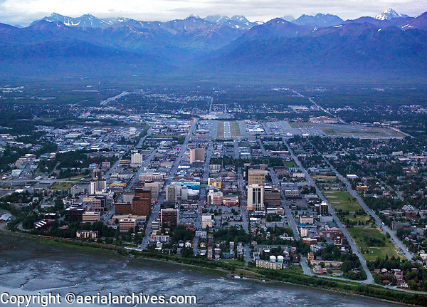 aerial photograph of Anchorage, Alaska from the Cook Inlet and the final approach into Merrill Field Airport (MRI) at dusk during the summer time; this photograph was taken at 10:26pm on June 30, 2007.  Merrill Field can be seen toward the middle back of the photograph