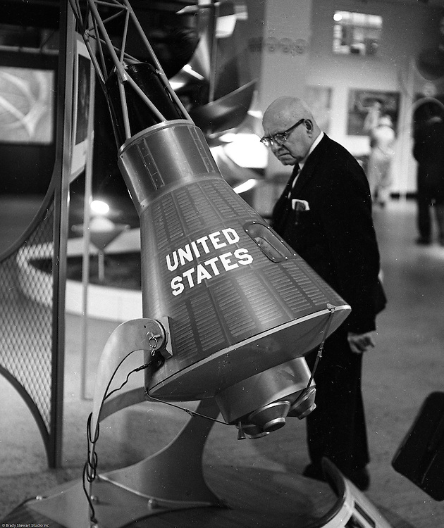 Client: US Steel<br /> Ad Agency: US Steel Marketing<br /> Contact:<br /> Product: Steel displays and fixtures and consumer products made from steel.<br /> Location: Hornes Department Store in downtown Pittsburgh<br /> <br /> View of a man looking at the US Steel space capsule display at Horne's department store in downtown Pittsburgh.  Steel products were displayed at Horne's during the Rhapsody of Steel campaign.  US Steel launched an awareness campaign of all the current uses of steel in everyday products.  During this time, ALCOA Aluminum Company of America also headquartered in Pittsburgh, was aggressively competing to enter markets where US  steel companies traditionally dominated market share. Examples included beer and food Cans, appliances, automobile parts, children's toys/bicycles, and more.