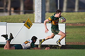 Trent White evades Teisam Faimasasa as he crosses the the tryline near the corner flag to score his second try of the afernoon. Counties Manukau Premier Club Rugby game between Pukekohe and Manurewa, played at Colin Lawrie Fields, Pukekohe, on Saturday May 28th, 2016. Pukekohe won the game 62 - 18 after leading 19 - 10 at halftime. Photo by Richard Spranger.