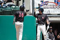 Visalia Rawhide third baseman Drew Ellis (10) congratulates Ramon Hernandez (16) after a two-run home run during a California League game against the Stockton Ports at Visalia Recreation Ballpark on May 9, 2018 in Visalia, California. Stockton defeated Visalia 4-2. (Zachary Lucy/Four Seam Images)