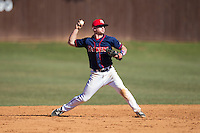 Shippensburg Raiders shortstop Mike Marcinko (2) makes a throw to first base against the Belmont Abbey Crusaders at Abbey Yard on February 8, 2015 in Belmont, North Carolina.  The Raiders defeated the Crusaders 14-0.  (Brian Westerholt/Four Seam Images)