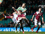 Chaos in the Celtic penalty area as Adam Matthews and Steven Doris come to grips with each other as a ball is crossed in
