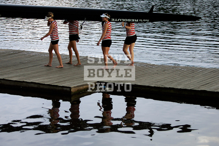 Rowers from Florida Tech carry their boat from the water following a third place finish in the Women's Varsity Heavyweight Eight Division II &III Final during the 68th Dad Vail Regatta on the Schuylkill River in Philadelphia, Pennsylvania on May 13, 2006.........