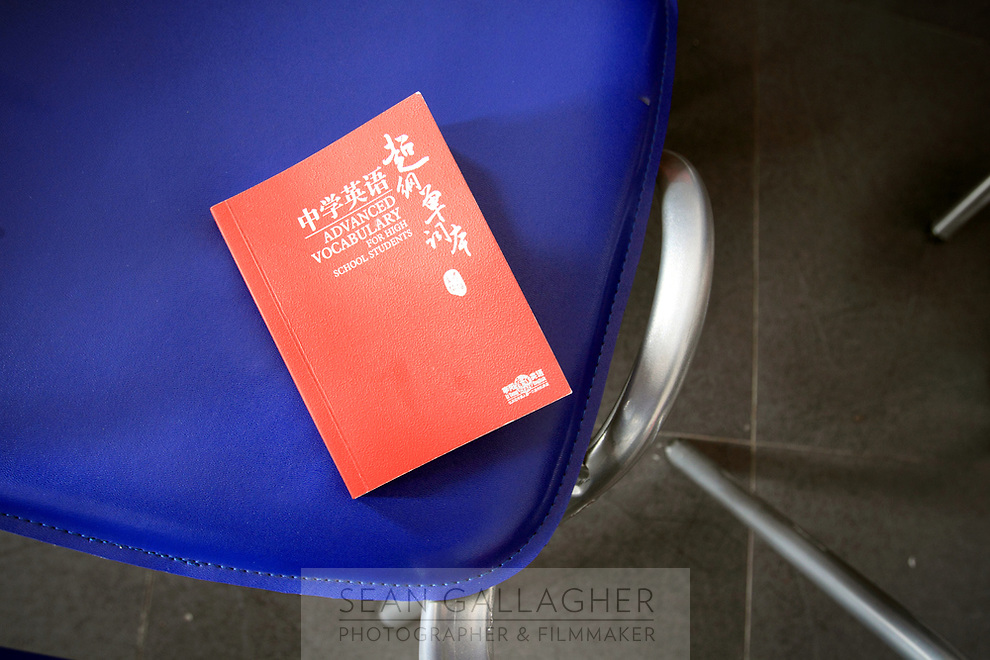 CHINA. A student's book at  the Li Yang 'Crazy English' school in Beijing. The school is famous for having hundreds of students chanting English together during classes. 2009