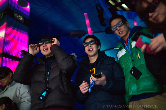 Visitors use glasses to watch 3D plasma displays at an exhibition of future technology at the SK T.UM future museum in Seoul, South Korea, on Jan. 31, 2012.