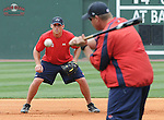 Manager Kevin Boles (19) of the Greenville Drive works with infielder Will Middlebrooks (11) in a fielding drill prior a game on July 5, 2009, against the Savannah Sand Gnats at Fluor Field at the West End in Greenville, S.C. (Tom Priddy/Four Seam Images)