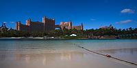 Paradise Island Atlantis Resort reflecting in the morning on the wet sand of a beach on Paradise Island, near Nassau, Bahamas