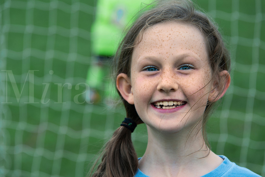 Girl at a youth soccer game.
