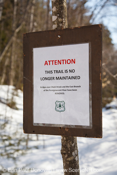"""""""Attention - This trail is no longer maintained"""" sign near Black Brook along the Wilderness Trail in the Pemigewasset Wilderness of the White Mountain National Forest in New Hampshire. This section of trail is officially closed."""