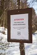 """Attention - This trail is no longer maintained"" sign near Black Brook along the Wilderness Trail in the Pemigewasset Wilderness of the White Mountain National Forest in New Hampshire. This section of trail is officially closed."