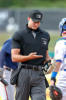 Home plate umpire Dillon Wilson heads to his position during the game between the Mississippi Braves and the Tennessee Smokies at Smokies Stadium on July 16, 2021, in Kodak, Tennessee. (Danny Parker/Four Seam Images)