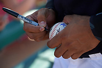 Detroit Tigers shortstop Dixon Machado (49) autographs a baseball after an exhibition game against the Florida Southern Moccasins on February 29, 2016 at Joker Marchant Stadium in Lakeland, Florida.  Detroit defeated Florida Southern 7-2.  (Mike Janes/Four Seam Images)