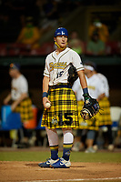 Savannah Bananas catcher Nick Clarno (15) warms up the pitcher during a Coastal Plain League game against the Macon Bacon on July 15, 2020 at Grayson Stadium in Savannah, Georgia.  Savannah wore kilts for their St. Patrick's Day in July promotion.  (Mike Janes/Four Seam Images)