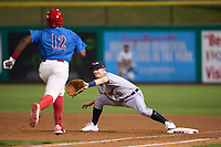 Lakeland Flying Tigers first baseman Jimmy Kerr (8) stretches for a throw as D.J. Stewart (12) runs up the base line during a game against the Clearwater Threshers on May 5, 2021 at BayCare Ballpark in Clearwater, Florida.  (Mike Janes/Four Seam Images)