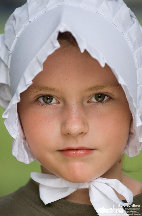 Young girl wears a pioneer woman's bonnet