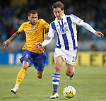 Real Sociedad's Mikel Oiarzabal (r) and FC Barcelona's Dani Alves during La Liga match. April 9,2016. (ALTERPHOTOS/Acero)