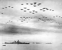 F4U's F6F's fly in formation during surrender ceremonies; Tokyo, Japan.  USS MISSOURI (in) left foreground.  September 2, 1945. (Navy)<br /> NARA FILE #:  080-G-421130<br /> WAR & CONFLICT BOOK #:  1370