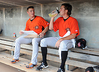 Pitcher Dylan Bundy (6), left, of the Frederick Keys charts pitches and talks with starting pitcher Tyler Wilson (26), right, in the dugout in a game against the Myrtle Beach Pelicans on August 4, 2012, at TicketReturn.Com Field in Myrtle Beach, South Carolina. Myrtle Beach won, 4-3. Bundy is the Baltimore Orioles' No. 1 prospect, according to Baseball America. (Tom Priddy/Four Seam Images)
