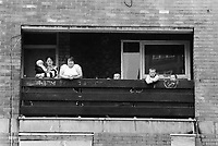 England. Greater Manchester. Salford. Women living in poverty. Two mothers and their children stand on balcony.  Salford is a city in the Metropolitan Borough of Salford in Greater Manchester. North West England is one of nine official regions of England. © 1990 Didier Ruef